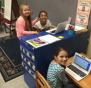 Kylee Walton (bottom), Taya Thomas and Maria Streety (above) at work on the Chromebooks Tuesday.