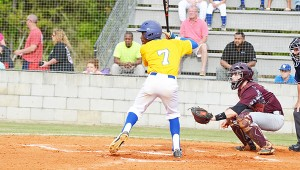 File photos Above: Hawthorne stiff arms a defender. Below: Hawthorne gets a lead off first base; Eyes a pitch to hit.