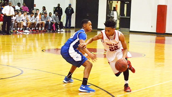 Corey Williams | The Brewton Standard TRM's Chardian Johnson drives to the basket.