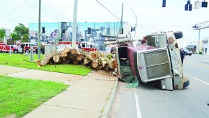 File photo Overturned log trucks are common occurrences at the intersection.