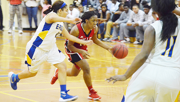 Miller's Mekhia Williams dribbles to the basket while Neal's Alyssa English defends