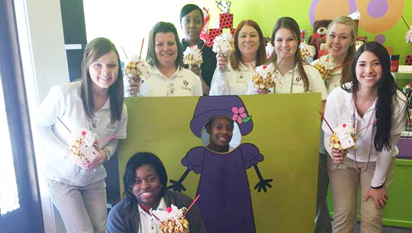 Courtesy photo Jefferson Davis Community College nursing students took time to volunteer with Meredith's Miracles' sundae fundraiser last week. The organization, which is based in Covington County, helps families with non-medical related expenses when dealing with illness. Families in Escambia County are eligible for benefits. Pictured are Paige Grantham, Tameshia Hooks, Claudette Johnson, Laurie Dove, Ashley Adams, Crystal Calvert, Courtney Sova, Casey Nolen and Sarah Lunsford