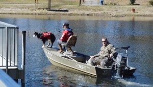 Stephanie Nelson | The Brewton Standard Cadaver dogs were called in Monday afternoon to assist in the search. Here, a crew makes its way across the waters of Alco Lake while others search the woods and surrounding areas.