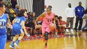 Corey Williams | The Brewton Standard No. 44 Aleria Smith crosses over an Atmore defender on her way to the basket.