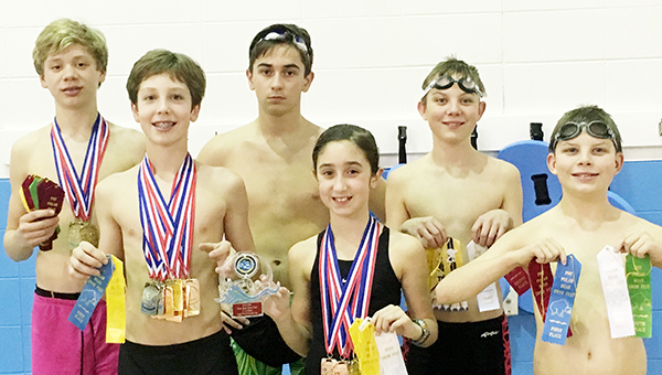 Courtesy photo  The Tigersharks performed well at the PNY Polar Bear Swim Fest in Gulfshores having numerous swimmers placing at the top of their age group. Pictured in the back row from left to right is Cole Jernigan, Colby Morris and Dean Thelen. Front row from left to right, Nolan Atkinson, Kinsley Byrd and Jacob Thelen.