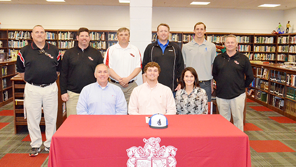 Corey Williams | The Brewton Standard Present at Floyd's signing was (in back from left) TRM coach Marc Edge, TRM assistant baseball coach Chris Baxter, TRM head baseball coach Kevin Madden, Alabama Southern head baseball coach Daniel Head, Alabama Southern assistant baseball coach Eli Cook and TRM athletic director Jamie Riggs. Up front, parents Robbie and Stephanie Floyd.