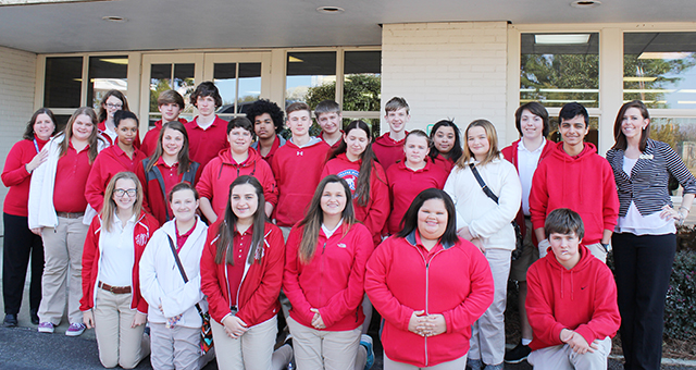 Courtesy photo Pollard-McCall eighth graders pose with Trustmark's Alexia Swain after a recent trip to the bank. The students spent the day touring select sites in preparation for their transition into high school.