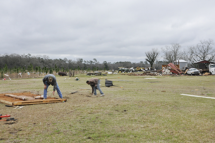 Neighbors help begin the cleanup process Friday morning.
