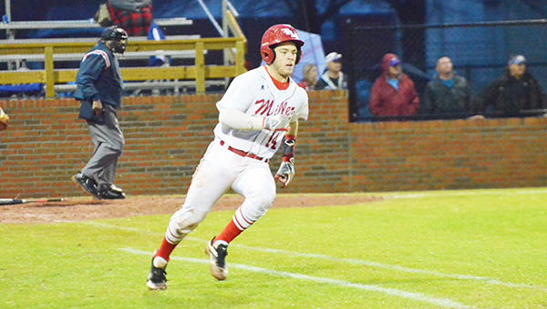 Corey Williams| The Brewton Standard Miller's Hunter Brittain looks to round first base after a hit against Fairview.
