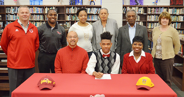 Corey Williams   The Brewton Standard Johnson signs his letter of intent to play football at Tuskegee University. Present at the signing were TRM head football coach Jamie Riggs; TRM head basketball coach Juan Johnson; sister Netaliah Johnson; his grandparents, Leola Johnson and Charlie Johnson; and school principal Mary Bell, and his parents, Durell and Shirley Johnson.