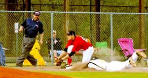 Corey Williams | The Brewton Standard Miller third baseman Jason Konsler fields a throw to third base.