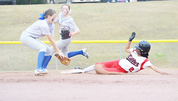 Corey Williams | The Brewton Standard Morgan Longmire slides safe into second base on a steal.