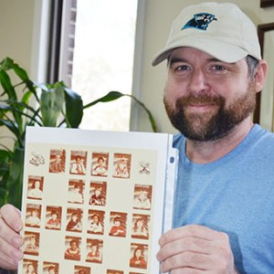 Gary Stuckey holds a photo of his North Brewton school class.