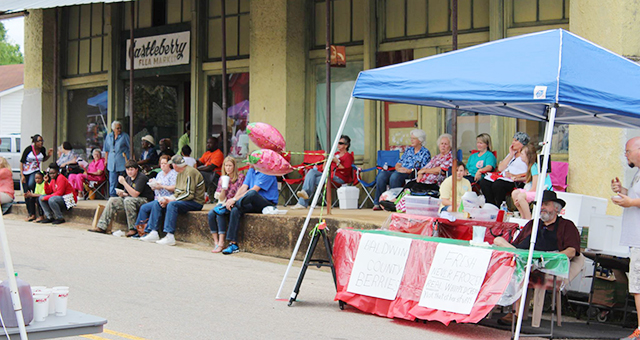 Courtesy photos The streets of downtown Castleberry will be filled Saturday as the town kicks off its annual Strawberry Festival. Pictured is a scene from last year's event.
