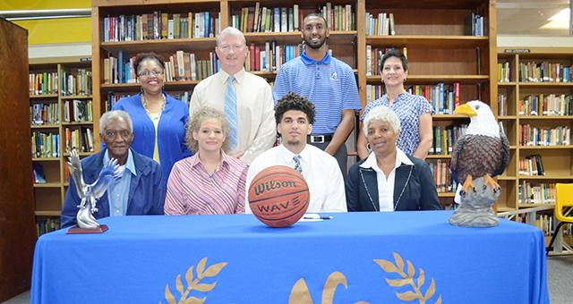 Corey Williams | The Brewton Standard Davis signs with Alabama Southern. Pictured, back, left-to-right;  Leketha Bradley, counselor; WSN head basketball coach Dewan Salter; ASCC head basketball coach Trent Eager; WSN high school principal Patricia Frazier; front row L-R- Grandfather McCluster Wright; mother, Christy Williams; Tyshawn Davis; and grandmother, Gwendolyn Miller Wright.