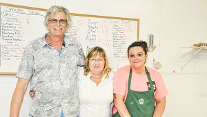 Stephanie Nelson | The Brewton Standard Barry and Robin Carraway, owners of Donut Delite, are pictured with cashier Aly Williams.