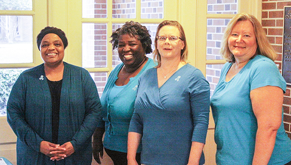 Courtesy photo Not to be left out - staff members Vanessa Kyles, Director of Financial Aid; Dr. Marilyn Nicholson, counselor; Joyce Elliott, student support services, and Kim Fleming, financial aid assistant, show off their teal as well.