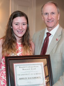 Ashley Daugherty is one of 16 UA undergrads recognized for research. She is pictured with a UA staff member.