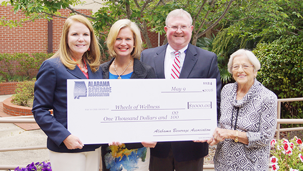 Courtesy photo Dale Ash, Co-Owner, Pepsi Bottling Atmore; Virginia Banister, Executive Director with Alabama Beverage Association; Chris Griffin D.W. McMillan Memorial Hospital administrator and Ruth Harrell, Escambia County Healthcare Authority board president, pose for a photo.
