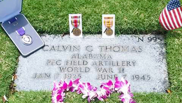 Pictured is Thomas's gravesite in Hawaii. Left: Mary Turner and Kathy Boyce pose for a photo.