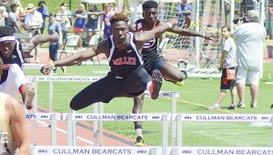 Amhad Taylor clears a hurdle in the 110-meter race.