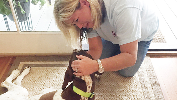 Courtesy photo Charlie is greeted by former owner Tracey Dove Tuesday.