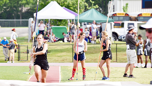 Stephanie Nelson | The Brewton Standard TRM's Peyton Baxter heads toward the mat while Morgan Manning talks with a fellow pole vaulter.