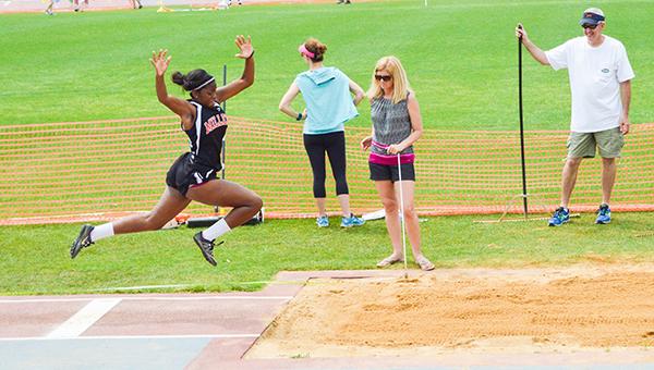 Stephanie Nelson | The Brewton Standard Shayn Bradley competes in the triple jump.
