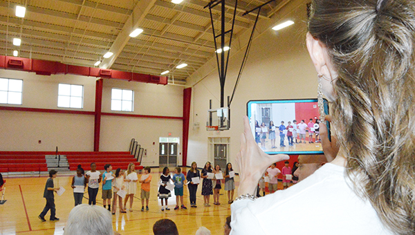 Family members video and photograph Tuesday's BMS awards ceremonies. Next year, new access points mean wireless internet throughout the school and faster upload times for parents.