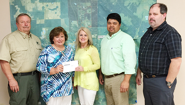 Courtesy photo Brewton's Georgia Pacific Mill recently donated $5,000 to the Conecuh-Sepulga and Blackwater River Clean Water Partnership. Pictured are Mike Older, Alabama Forestry Commission and CSBCWP Chairman; Janet Wofford, CSBCWP facilitator; Suzanne Anderson, GP's public affairs manager; Roberto Flores, GP's environmental and compliance manager; and, Stephen Greer, GP's environmental engineer.