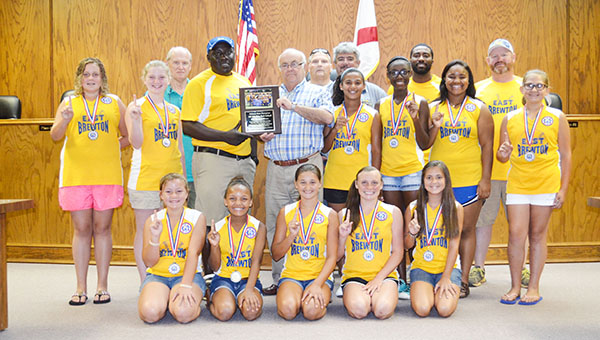 Corey Williams | The Brewton Standard East Brewton mayor Terry Clark presents the East Brewton girls 12U softball team with a plaque celebrating the team's state title victory in Andalusia.  Receiving the plaque was head coach Doug Sims, players present, back row, left to right: Teresa Harris, Natalie Wyatt, Jayda Johnson, Nakasia Smith, Madison Hawthorne, Jailyn Bondurant; front row, left to right: Madison Nelson, Gracie Sims, Ashli Wyatt, Madison White and Harley Wilson. Not pictured Kendall Carpenter. Assistant coaches pictured are Damien Jackson and Jason Wyatt. Not pictured is Alex Hawthorne.