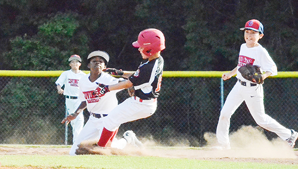 Corey Williams | The Brewton Standard Brewton's Caleb Silbernagel gets tagged out at second base by Covington County shortstop Javen Poindexter. Brewton went on to lose the game 2-0 for its first loss of the tournament.