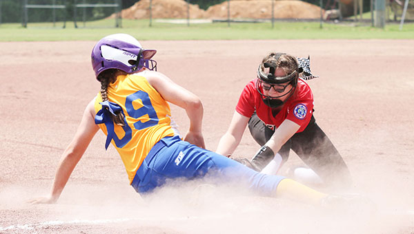 Photo by Allison Terrell East Brewton's Madison White safely steals third base.