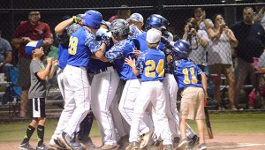 Josh Dutton | Andalusia Star-News East Brewton's Nathan Pate gets mobbed at the plate after crushing a two-run blast in the top of the first inning of East Brewton's win over Covington County on Friday night.