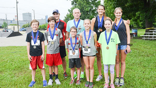 Corey Williams | The Brewton Standard Pictured are category winners of the Blueberry 5K run. Below participants enjoy a good time on the course.