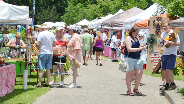 Corey Williams | The Brewton Standard Festival goers look around at the variety of items being sold on Saturday.