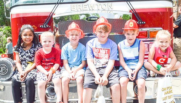 Corey Williams | The Brewton Standard From left to right, Katie Harris, Trey Lynn, Nolan Lynn, Nick Lynn, Nathan Lynn and Cady Lynn pose with the fire truck.