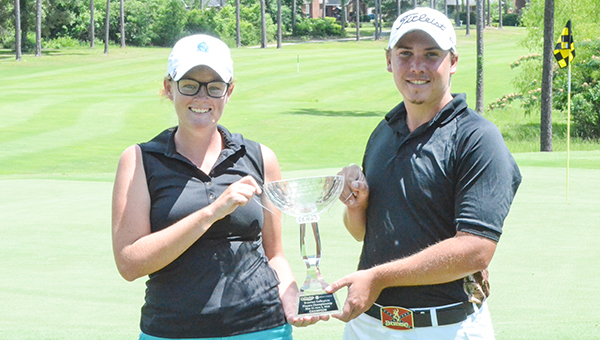 Corey Williams | The Brewton Standard Lamm and Westmoreland hold the first trophy after winnning the women's and men's division of the Southeastern Collegiate Golf Hardees/Windcreek Casino Brewton Collegiate Classic.