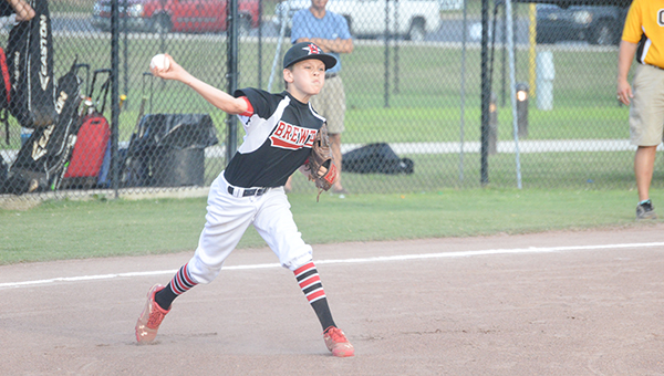 Josh Dutton | Andalusia Star-News Brewton starting pitcher Miller Hart fields and bunt and fires to first for the out in Sunday's championship game against Opp in the Cal Ripken 12U district tournament in Andalusia.