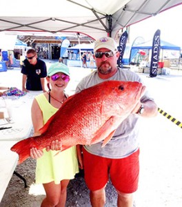 Courtesy photo Emma Claire Hayes from Brewton with her dad, Kyle Hayes holds the 26 pound Red Snapper she caught on Friday.