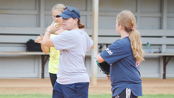File photo Coach Misti Nims work with campers on the infield.