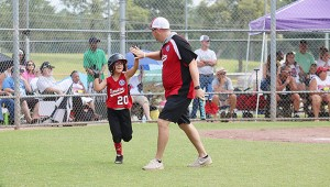 Photo by Allison Terrell Claire Smith gets a high five from coach John Robert Fountain after scoring a run