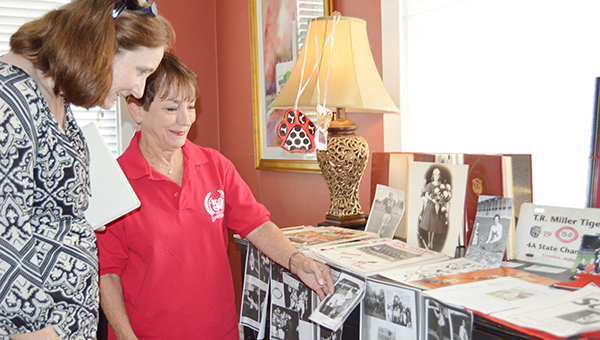 Stephanie Nelson   The Brewton Standard It was a 'rah-rah' good time Thursday as locals kicked off the Smithsonian exhibit 'Hometown Teams' with a pep rally at English Realty. Here, Brewton's director of program management Connie Baggett looks over some of the donated items with Betty Pickard.