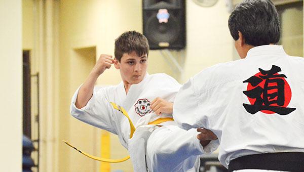Corey Williams | The Brewton Standard Yoshuaki teacher Hirokai Toyama works with student and yellow belt Bryan Parker at the YMCA.
