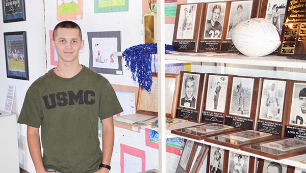 Corey Williams | The Brewton Standard Exhibit employee Tristan Turner posing with memorabilia.