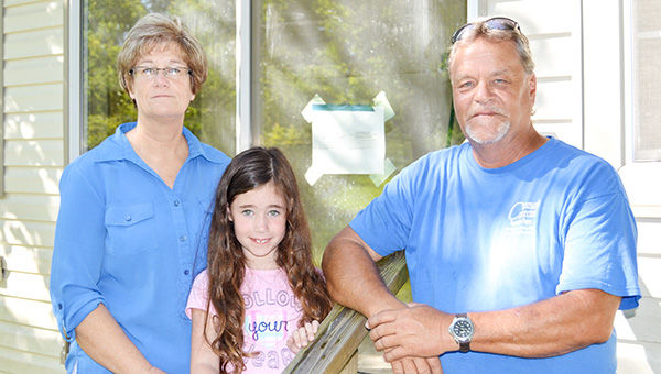 Stephanie Nelson | The Brewton Standard The Garrett family – Chuck, Marcia and their 7-year-old granddaughter, Kenslee – are one of two families who received a new home through New Beginnings Sunday