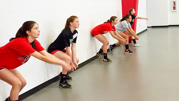 Courtesy photo The BMS volleyball team does a drill at camp last week.