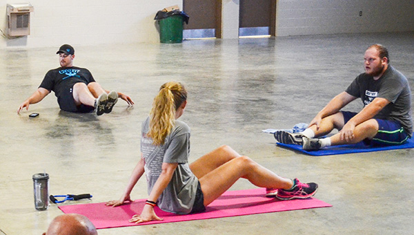 Corey Williams | The Brewton Standard Blake Crosby leads his Tabata Bootcamp class in an exercise.
