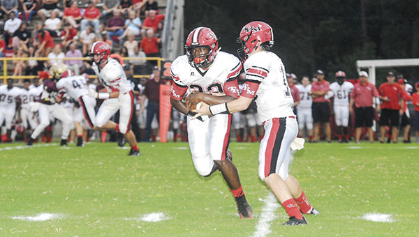 Jason Boothe | Washington County News TRM's Michael Campbell gets the hand off from quarterback Caleb Winton.