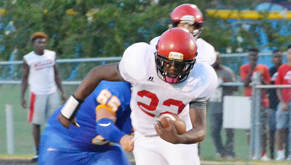 Corey Williams | The Brewton Standard Narkavis Campbell (below) rushes agaisnt WSNMS, ending with over 100 yards at night end.